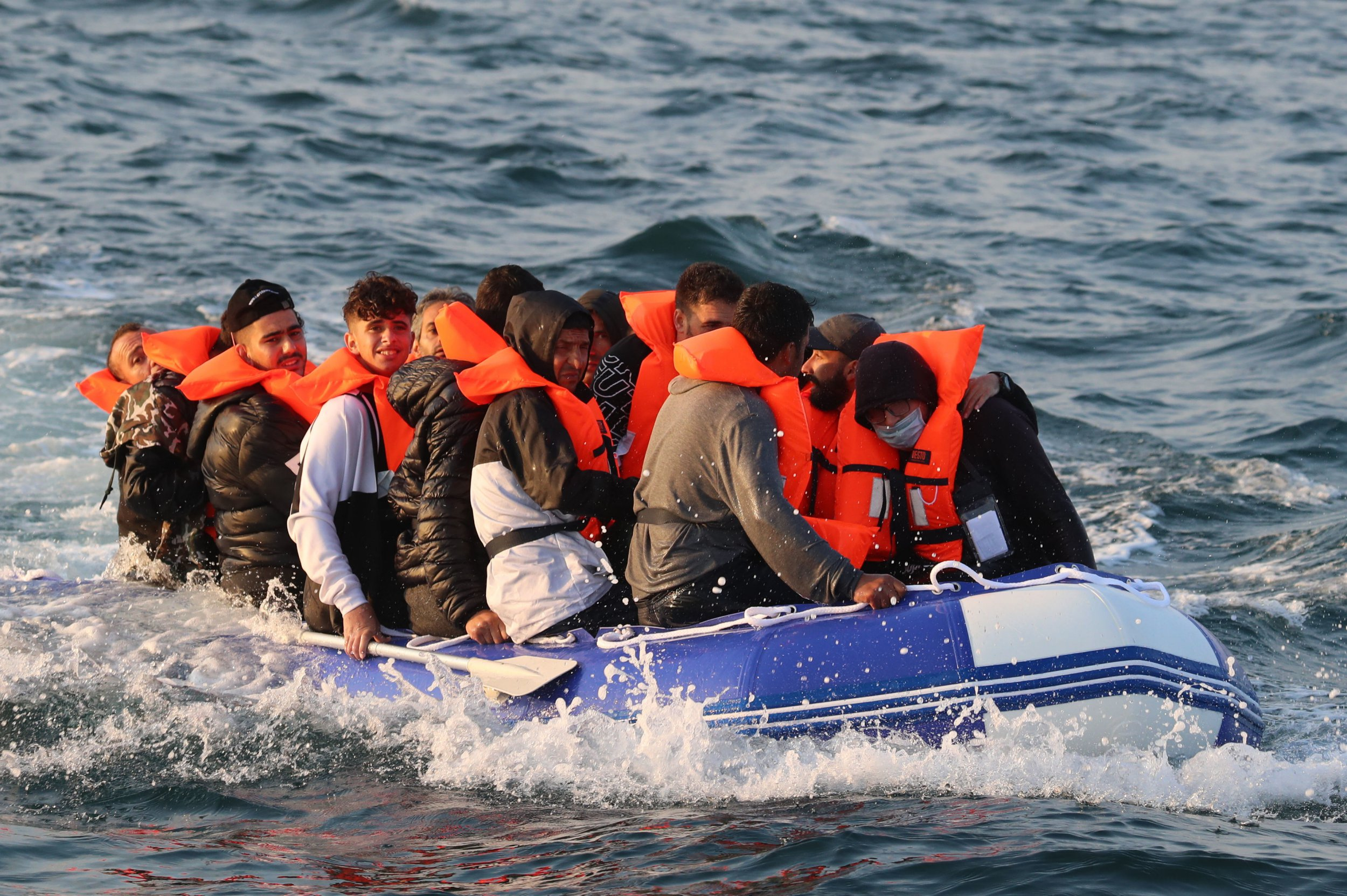 Refugees crossing the channel in a rubber boat