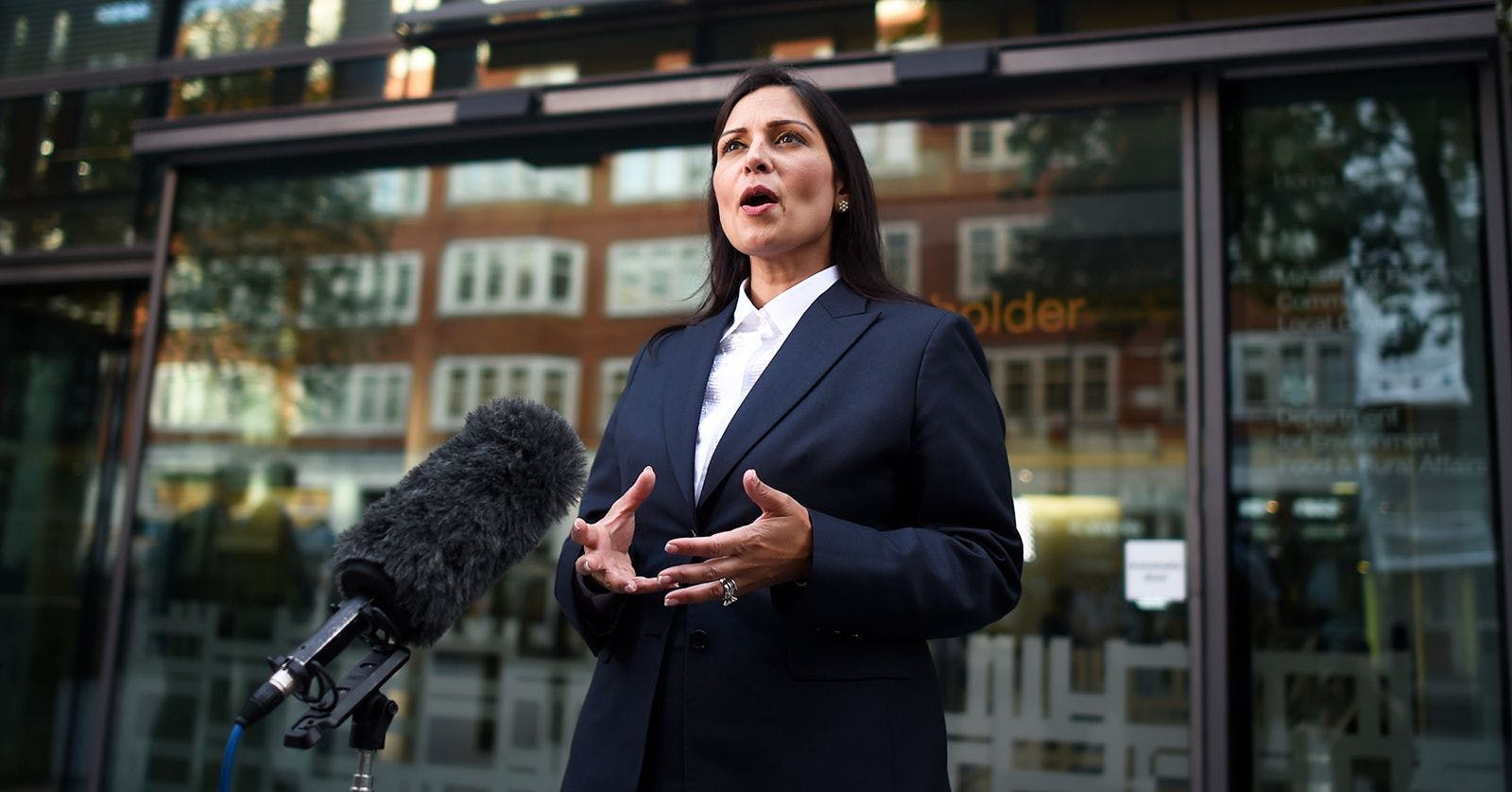 Priti Patel giving a press conference