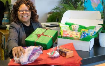 Chantal with Christmas presents for survivors of torture